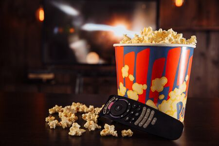 TV with friends online concept. Whatching movies and eating popcorn in the bowl.
