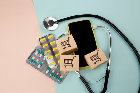Online pharmacy. Lots of pills, stethoscope and boxes with medication. The concept of convenient choice of medicines