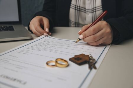 Woman signing marriage contract, closeup. Banque d'images