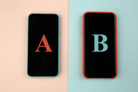 Conversion funnel, A B test in marketing and online advertising. Two smartphone with colored letters A and B on colorful background