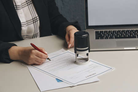 Female notary stamping agreement, company secretary, official document, validity.