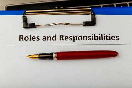 Roles and responcibilities document in the tablet at the desk.