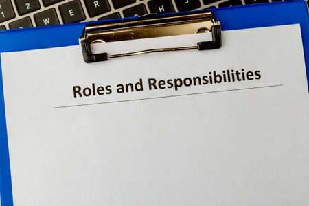 Roles and responsibilities document in the tablet at the laptop on the table.