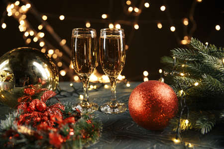 Ribbon, baubles and wine against Christmas lights Banco de Imagens