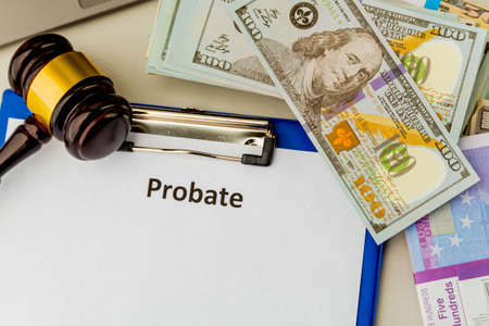 Legal probate statement. Money and lawyer attributes at the desk. Фото со стока