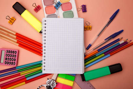 School office supplies on pink background