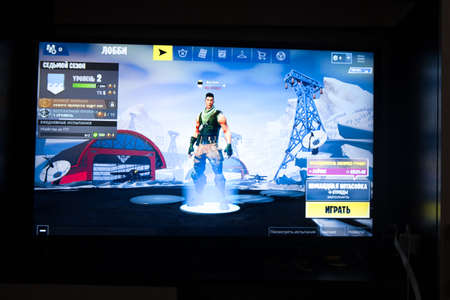 Tula, Russia - JANUARY 27, 2019 - Fortnite video game screen with character and console controller. Fortnight Battle Royale online gaming by Epic