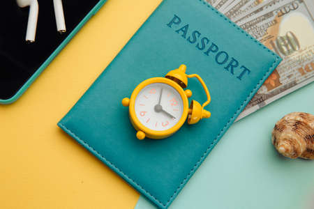 Outfit and accessories of traveler on yellow blue background close-up. Travel concept. Overhead view of travelers accessories 스톡 콘텐츠