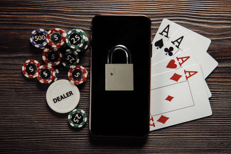Gambling and law theme. Smartphone, aces and padlock 스톡 콘텐츠