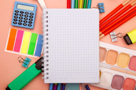 School supplies on pink background. Back to school abstract background. Creative flat lay with copy space 스톡 콘텐츠