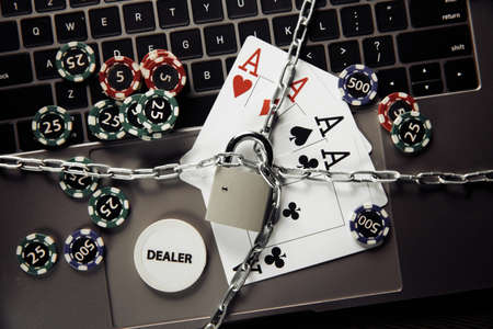Stop online casino concept with padlock, playing cards and keyboard 스톡 콘텐츠