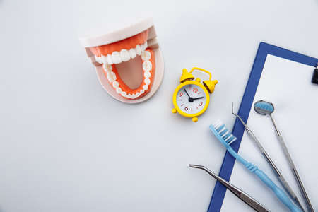 Teeth hygiene concept. Tooth model with dental tool in dentists office 스톡 콘텐츠