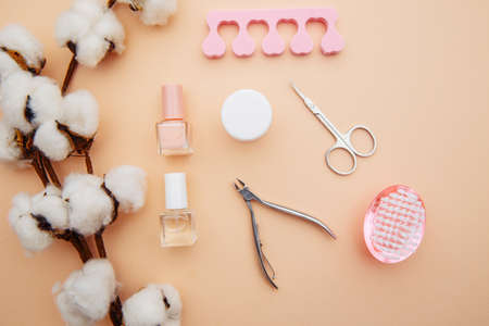Tools for creating and for the treatment of nails on pink background