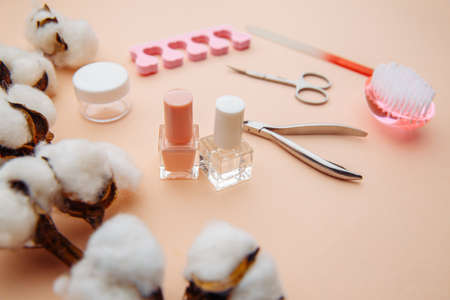 Beauty care. Tools for creating and for the treatment of nails on pink table Stock Photo