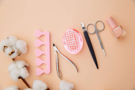 Beauty care concept. A set of professional tools for manicure and pedicure on pink background Zdjęcie Seryjne