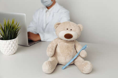 Teddy Bear with toothbrush at dentists office. Child healtcare concept