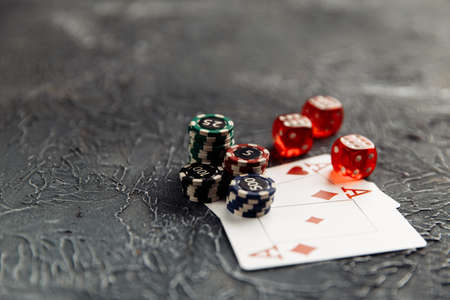 Chips, dices and playing cards with aces for poker online or casino gambling on table. Online casino concept