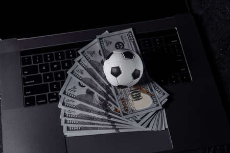 Bets, sports betting, bookmaker concept. Soccer ball on a keyboard