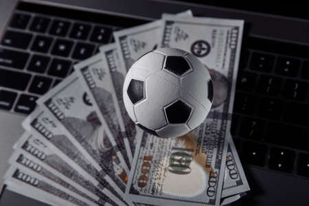 Bets, sports betting, bookmaker. Soccer ball on a laptops keyboard close-up