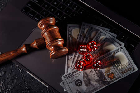 Law and rules for online gambling concept, judge gavel and dice