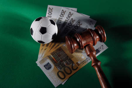 Soccer ball and judge gavel. Sport betting concept