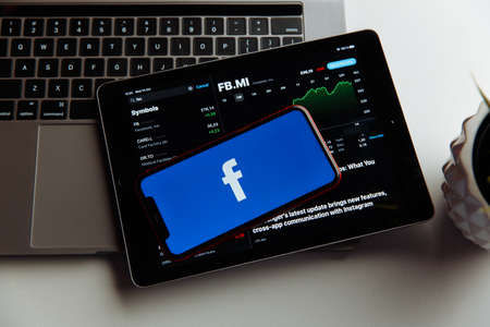 Tula, Russia - October 18, 2020: Facebook logo on iPhone display Editöryel
