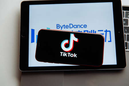 Tula, Russia - October 18, 2020: Tik-Tok logo on iPhone display
