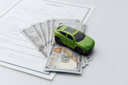 Toy car and contract on a white table. Car purcase concept Stock fotó