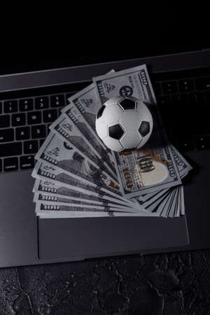 Bets, sports betting, bookmaker. Soccer ball on a laptops keyboard. Vertical image Stock fotó
