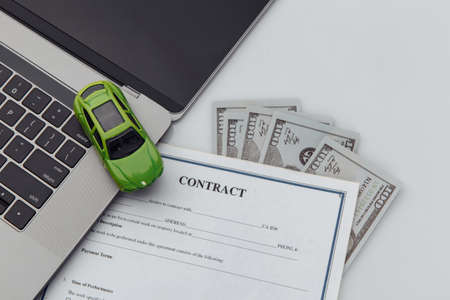 Purchase contract for a car with laptop and toy car