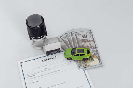 Purchase contract for a car with money, stamps and toy car