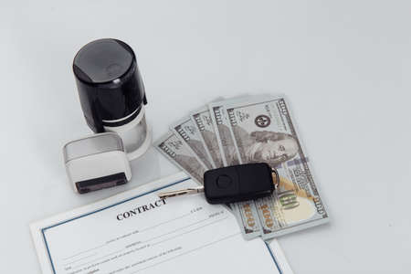 Purchase contract for a car with dollar banknotes, stamps and car keys Stock fotó