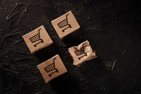 Damaged paper box on a grey background. Online shopping, service and delivery concept Stock fotó