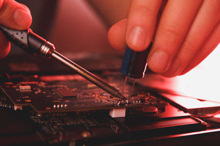 computer hardware engineering. developer soldering electronic component