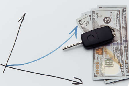 Car sales chart concept visual. Car keys, money and graph 版權商用圖片