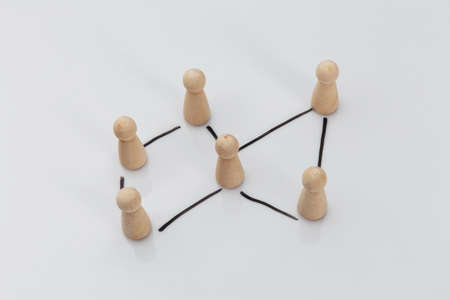 Wooden people on a white table, business concept, human resources and management concept 版權商用圖片 - 162029167