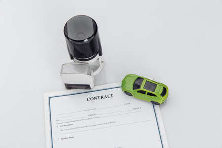 Purchase contract for a car with stamps and toy car