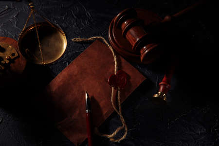 Lawyer tools. Scales of justice, envelope and wooden judges gavel