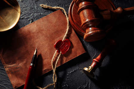 Scales of justice, envelope and wooden judges gavel close-up. Law and justice concept 版權商用圖片