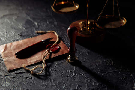 Law and justice concept. Scales of justice, brown envelope with seal and wooden stamp. Notary public tools 版權商用圖片