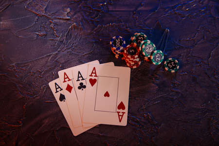 Online gambling сoncept. Aces and gambling chips on a grey background