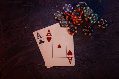 Online casino сoncept. Cards and stucks of gambling chips