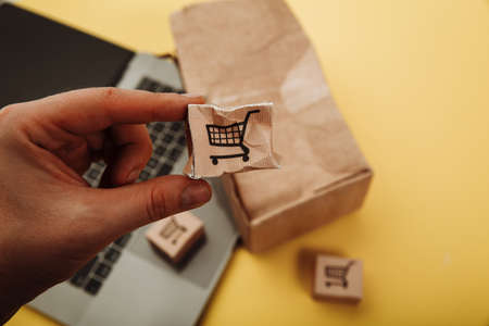 Spoiled small paper box in a hand. Online shopping and delivery concept. Shipment accident 版權商用圖片