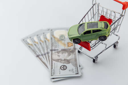Purchase a car, new car in a shopping basket