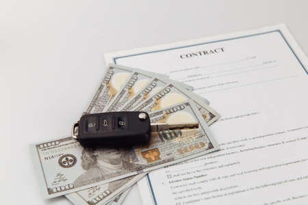 Key and contract on a table. Car purchase or insurance concept