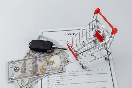 Car keys, money and shopping cart. Car sale or purchase concept 版權商用圖片 - 162029481