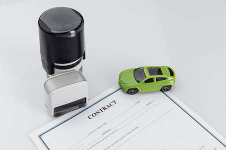 Rental agreement for a car with contract, stamps and toy car