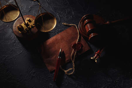 Notary tools. Scales of justice, envelope and wooden judges gavel