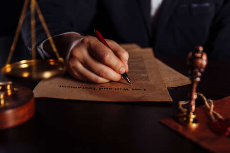 Man signing a Last Will and Testament document