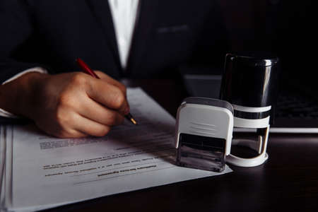 Businessman approved a contract at desk. Business concept